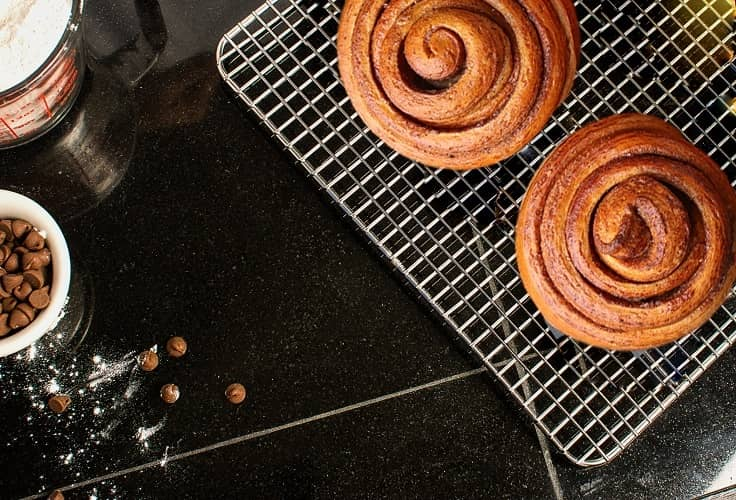 Homemade cinnamon rolls on cooling racks 2