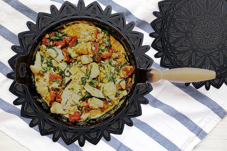 Creamy Tuscan Chicken recipe on trivets