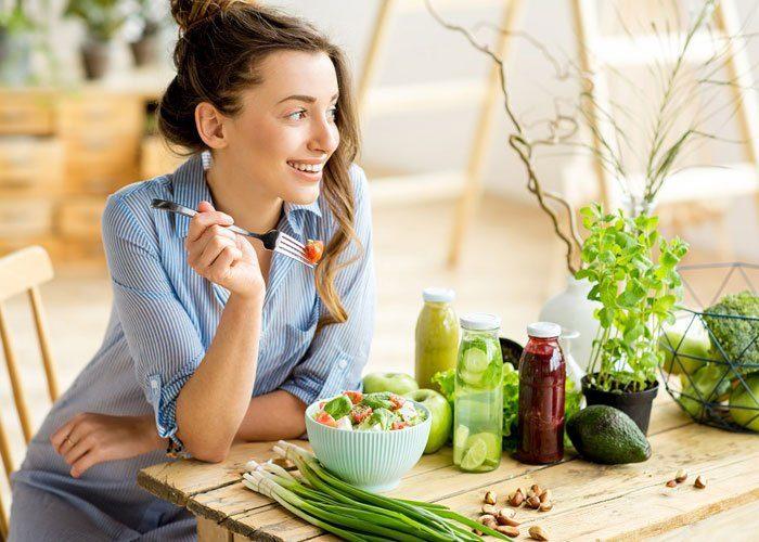 Young-woman-eating-salad-1 new